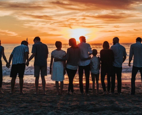 family united and happy on the beach